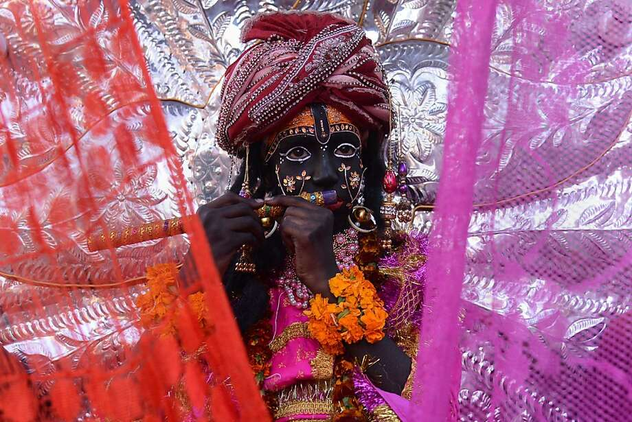 An Indian devotee dressed as Hindu Lord Krishna (C) participates in a procession in Amritsar on November 12, 2013, on the occasion of the birth anniversary of Bhagwan Namdev. Namdev was a poet-saint who is significant to the Varkari sect of Hinduism. He is also venerated in Sikhism. He is traditionally believed to have been born in 1270 AD in the village of Narsi Bahmani, in Hingoli district of Maharashtra, India.Most of the spiritual messages of Namdev emphasized the importance of living the life of a householder and that through marriage and having a family, one could attain Moksha - the liberation from samsara, the cycle of death and rebirth.  TOPSHOTS/AFP PHOTO/NARINDER NANUNARINDER NANU/AFP/Getty Images Photo: Narinder Nanu, AFP/Getty Images