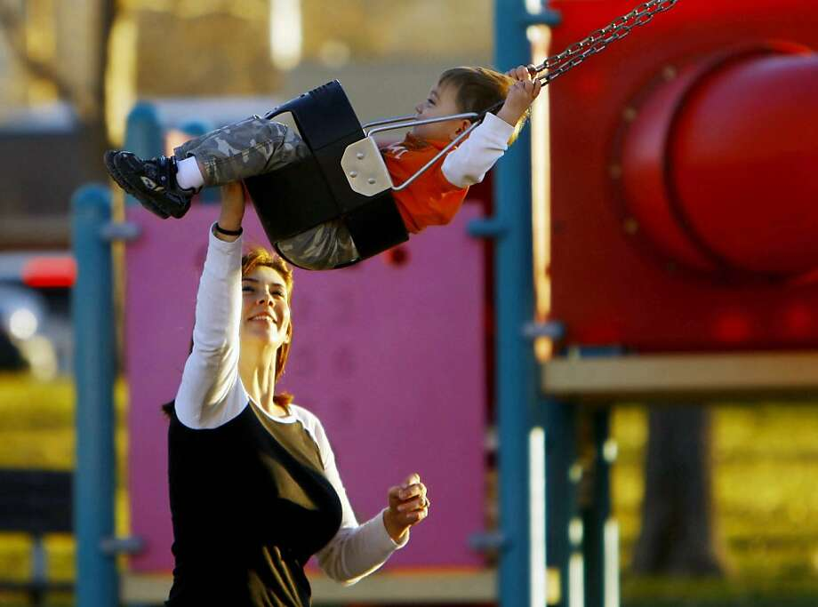 Amanda Cellmer pushes her son Bracen, 2, on the swing at City Park on Tuesday afternoon, Nov. 12, 2013 in Casper, Wyo. Cellmer and her sons Bracen, Jacob, 5, and Caleb, 3, decided to take advantage of the balmy weather and spend the afternoon in the park. (AP Photo/Casper Star-Tribune, Dan Cepeda) Photo: Dan Cepeda, Associated Press
