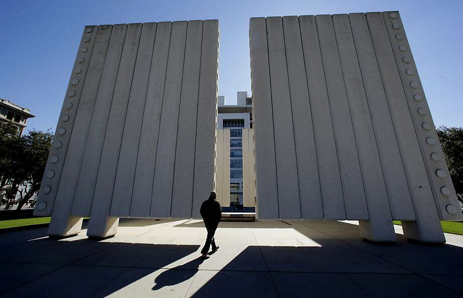 Chris Carson of Ashville, North Carolina, visits  the John Fitzgerald Kennedy Memorial in downtown Dallas, Tuesday, Nov. 12, 2013. Church bells tolling throughout Dallas and a moment of silence at 12:30 p.m. on Nov. 22 will mark the moment 50 years ago when President John F. Kennedy was assassinated. A year of commemorative events organized by organizations throughout the city culminates this month with a solemn ceremony the city of Dallas has planned in Dealey Plaza, where Kennedy's motorcade was passing as shots rang out.  (AP Photo/LM Otero) Photo: LM Otero, Associated Press