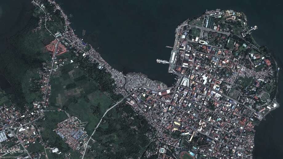 This photo provided by DigitalGlobe shows a Feb. 22, 2012 image of Tacloban, city, Leyte province, central Philippines before Typhoon Haiyan. Photo: DigitalGlobe Via Google, AP / DigitalGlobe via Google