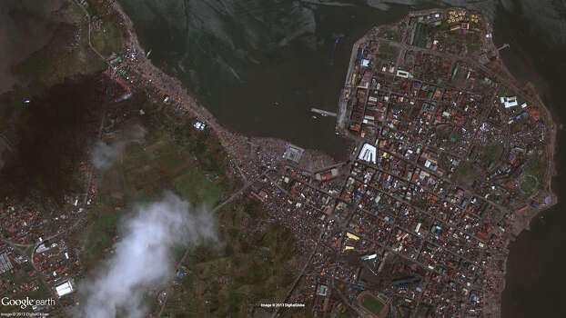 This photo provided by DigitalGlobe shows a Nov. 10, 2013 image of Tacloban, city, Leyte province, central Philippines after Typhoon Haiyan. Photo: DigitalGlobe Via Google, AP / DigitalGlobe via Google