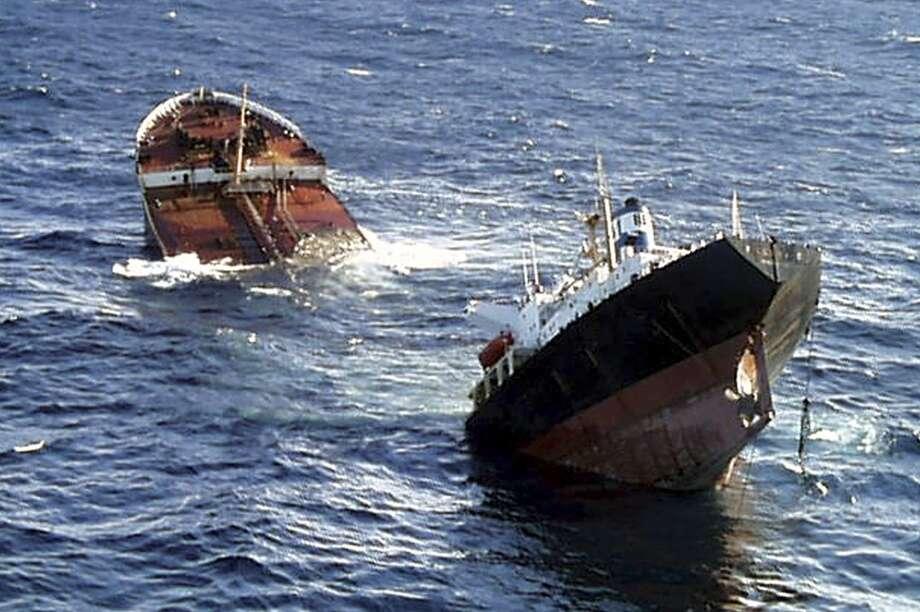 The Bahamas-registered Prestige oil tanker breaks in two pieces before sinking some 150 miles (241 kilometers) off Spain's coast in the Atlantic ocean on Nov. 19, 2002. Photo: Uncredited, ASSOCIATED PRESS