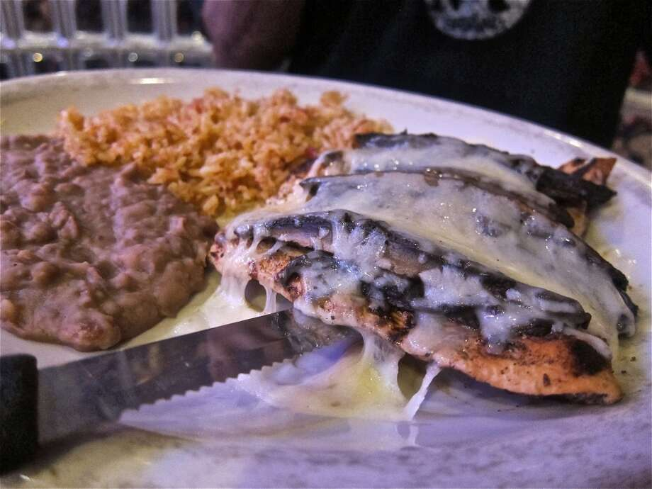 Pollo Poblano, grilled chicken with portobello and Jack cheese at Lupita's in Sugar Land. Photo: Alison Cook