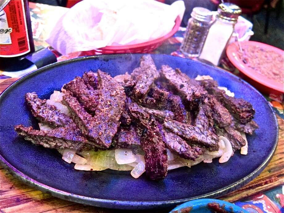 Beef fajitas for two at Lupita's in Sugar Land. Photo: Alison Cook