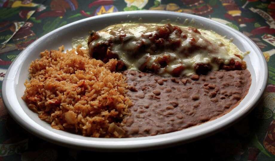 Mole chicken enchiladas at Lupita's Mexican Restaurant, Wednesday, Nov. 6, 2013, in Sugar Land. Photo: Karen Warren, Houston Chronicle / © 2013 Houston Chronicle
