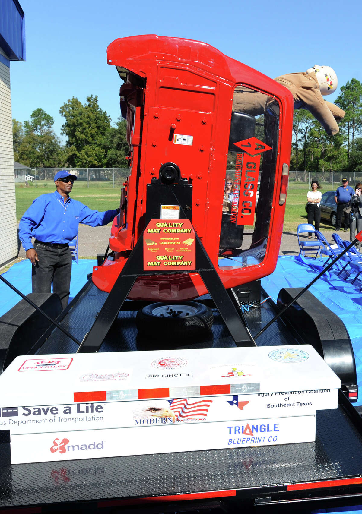 A mannequin begins to fly out of a rollover simulator operated by Kenneth Minkins at the County Commissioner Precinct 4 building on Tuesday. The simulator demonstrates the effects of not wearing a seat belt when a vehicle rolls in an accident. Photo taken Tuesday, November 12, 2013 Guiseppe Barranco/@spotnewsshooter