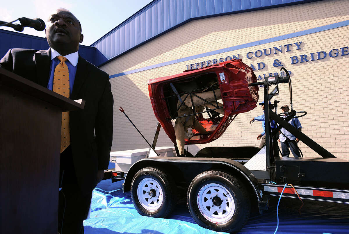 Everette Alfred speaks during a demonstration for a rollover simulator at the County Commissioner Precinct 4 building on Tuesday. The simulator demonstrates the effects of not wearing a seat belt when a vehicle rolls. Photo taken Tuesday, November 12, 2013 Guiseppe Barranco/@spotnewsshooter