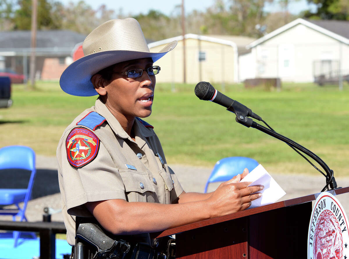 Trooper Stephanie Davis speaks during a demonstration for a rollover simulator at the County Commissioner Precinct 4 building on Tuesday. Photo taken Tuesday, November 12, 2013 Guiseppe Barranco/@spotnewsshooter