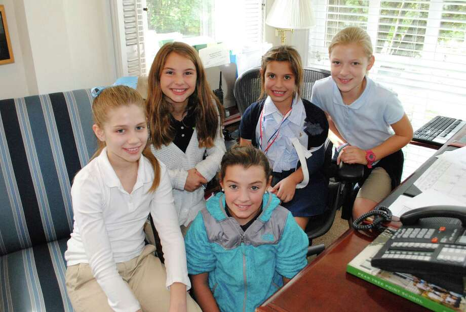 "As Pear Tree Point School's ""Headmistress of the Day,"" fifth-grader Gwen Thompson, second from right, enjoys a visit with her luncheon guests, from left, Caroline Blake, Caitlin Pasierb, Paige Benson and Charlotte Gelhaus in her ""office."" Photo: Contributed Photo, Contributed / Darien News"