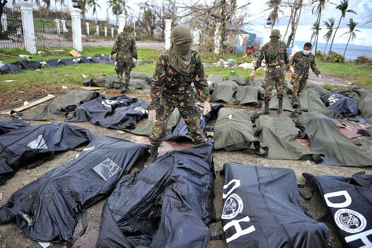 Body bags lie on the ground, left from Typhoon Haiyan is seen on November 13, 2013 in Tacloban, Philippines. Haiyan, possibly the most powerful typhoon on record, killed thousands of people upon hitting the Philippines and hundred of thousands flee and houses are blown to pieces. Photo: Anadolu Agency, Getty Images / 2013 Anadolu Agency