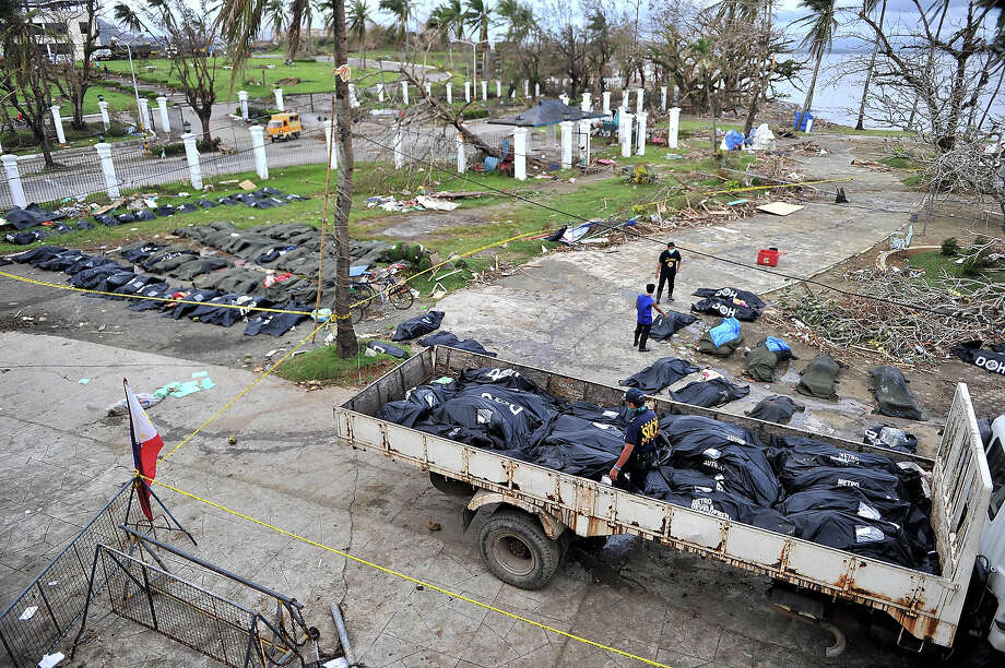 Body bags is loaded on a truck, left from Typhoon Haiyan is seen on November 13, 2013 in Tacloban, Philippines. Haiyan, possibly the most powerful typhoon on record, killed thousands of people upon hitting the Philippines and hundred of thousands flee and houses are blown to pieces. Photo: Anadolu Agency, Getty Images / 2013 Anadolu Agency