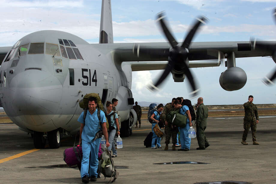 Foreign doctors on board a US C-130 plane arrive on November 13, 2013 to help people affected by typhoon in Tacloban, Leyte, Philippines. Typhoon Haiyan, packing maximum sustained winds of 195 mph (315 kph), slammed into the southern Philippines and left a trail of destruction in multiple provinces, forcing hundreds of thousands to evacuate and making travel by air and land to hard-hit provinces difficult. Around 10,000 people are feared dead in the strongest typhoon to hit the Philippines this year. Photo: Jeoffrey Maitem, Getty Images / 2013 Getty Images