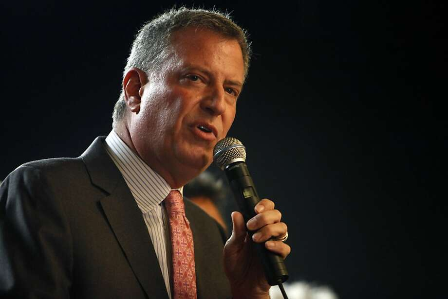 Unlike New Jersey Gov. Chris Christie, New York Mayor-elect Bill de Blasio, above, advocates policies favorable to working people. Photo: Ricardo Arduengo, Associated Press