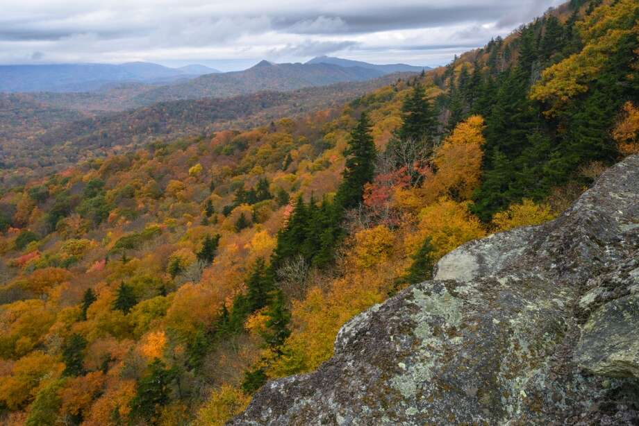 In this Oct. 19, 2013 photo provided by Grandfather Mountain changing leaves provide a frame for Cliffside Overlook on Grandfather Mountain in Linville, N.C. Photo: Skip Sickler, AP Photo/Grandfather Mountain
