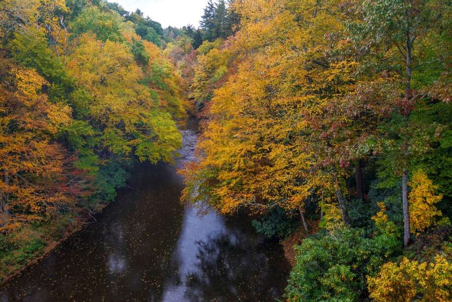 In this Oct. 19, 2013 photo provided by Grandfather Mountain changing leaves provide a frame for the Linville River above Linville Falls in Linville, N.C. Photo: Skip Sickler, AP Photo/Grandfather Mountain