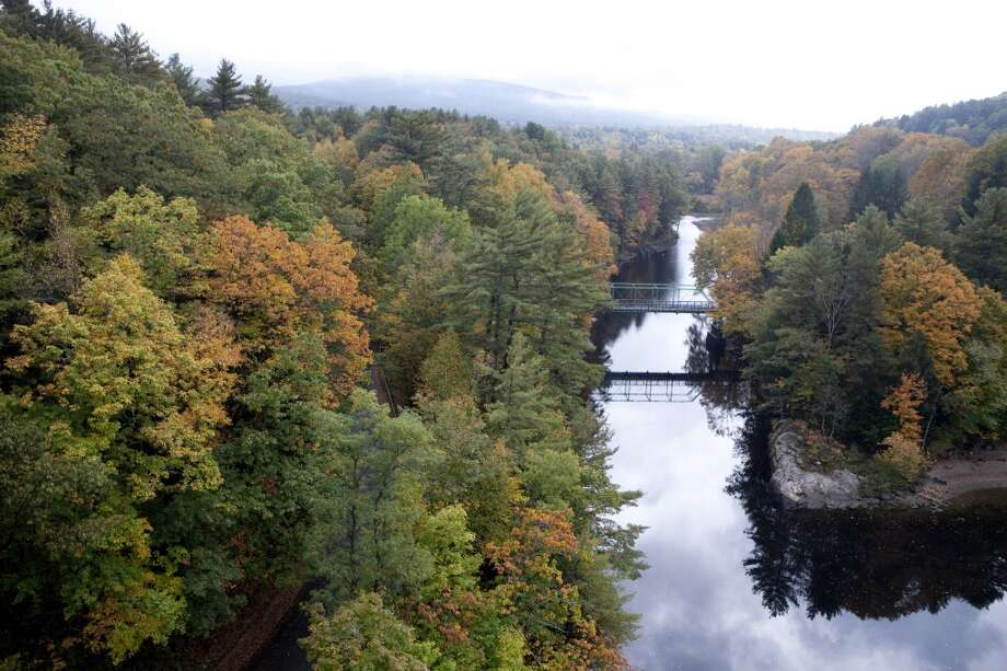 The fall leaves on the trees have turned orange, yellow and red by the Connecticut River, on October 7, 2013 in Gill, Massachusetts. Photo: Christian Science Monitor, Melanie Stetson Freeman/The Christian Science Monitor Via Getty Images