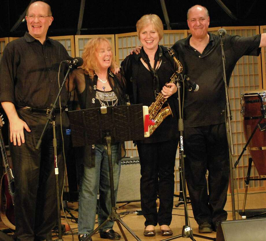 Musicians who will perform Joni Mitchell and Leonard Cohen songs in a benefit c0oncert for the Westport Historical Society include, from left, keyboardist Bob Cooper, vocalist Suzanne Sherisan, horn player Ruth Ahlers and percussionist Marshal Rosenberg. Photo: Contributed Photo / Westport News