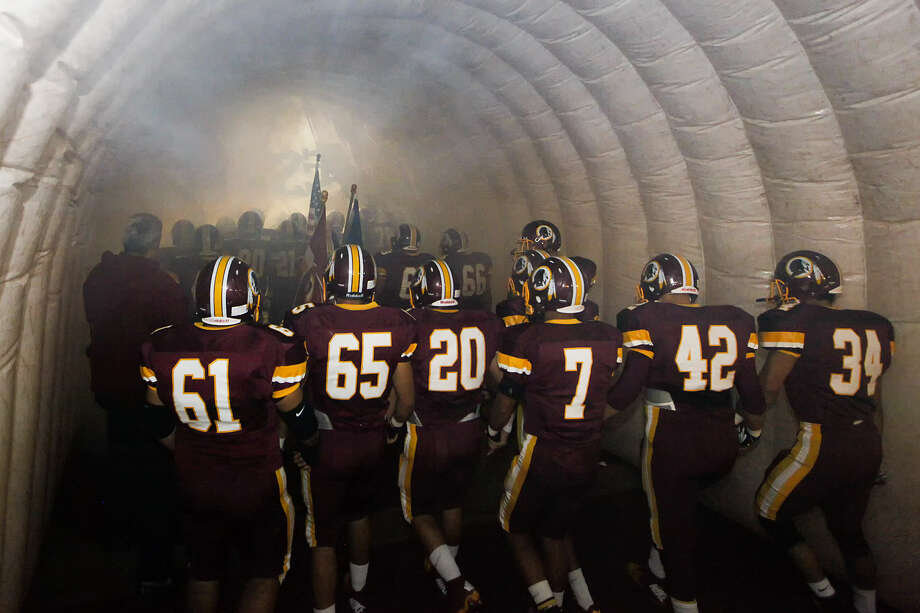 The Harlandale Indians head out of the tunnel onto the field prior to the start of the 50th annual Frontier Bowl. The Indians defeated McCollum and advanced to the playoffs. Photo: Marvin Pfeiffer/ San Antonio Express-News