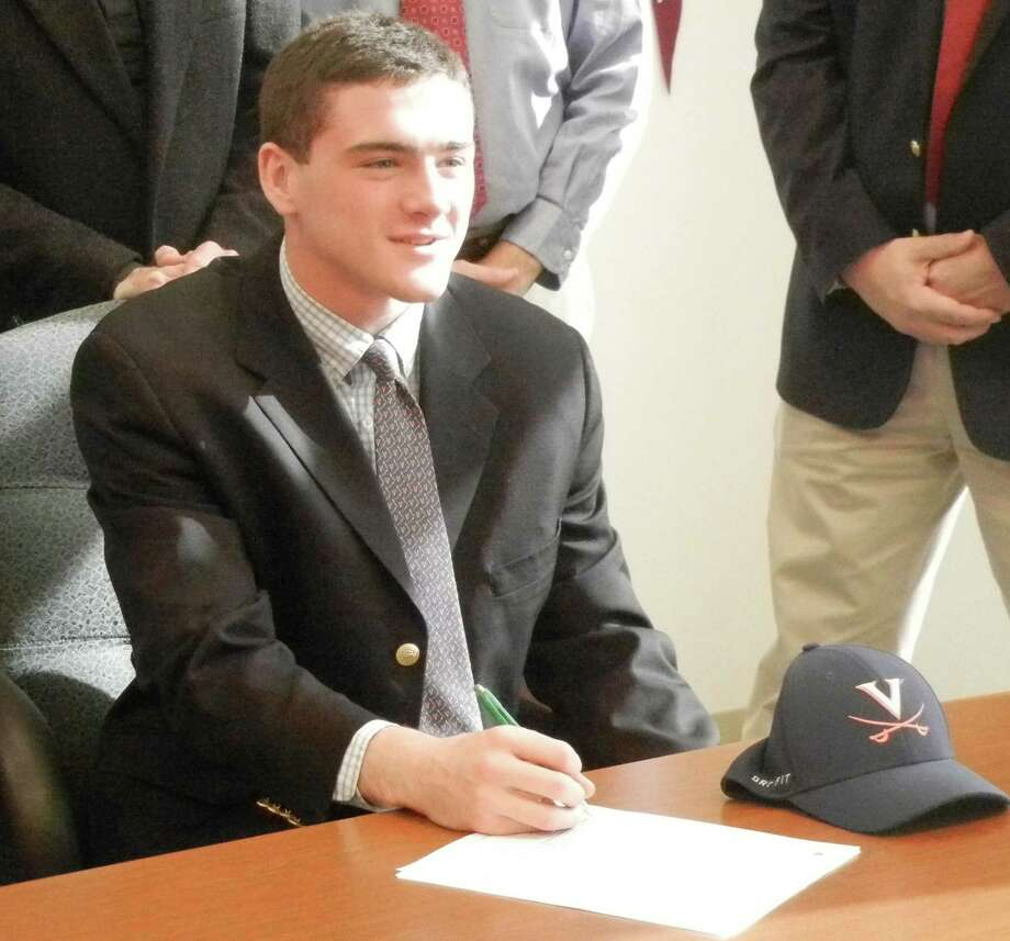 Fairfield Prep senior Jake Bowtell, of Darien, signing a letter of intent to attend the University of Virginia and compete in diving next year on Wednesday, Nov. 13 on the school's campus in Fairfield. Photo: Reid L. Walmark / Fairfield Citizen