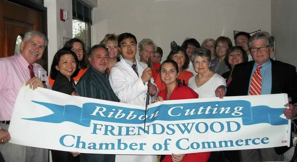 Dr. Hui Ouyang, his office staff and chamber officials at the ribbon-cutting ceremony.