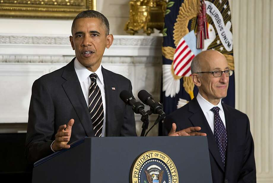 President Barack Obama announces that he will nominate Timothy Massad, right, as chairman of the Commodity Futures Trading Commission (CFTC), Tuesday, Nov. 12, 2013, in the State Dining Room of the White House in Washington. (AP Photo/ Evan Vucci) Photo: Evan Vucci, Associated Press