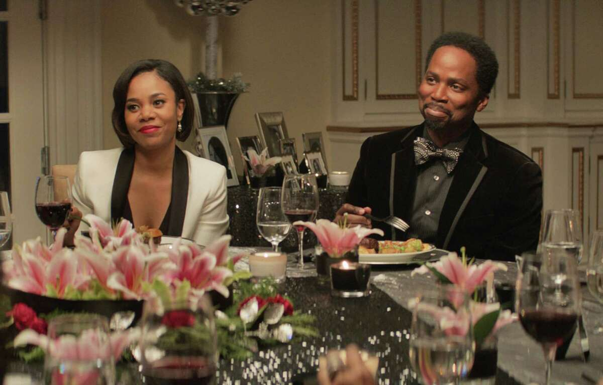 """This image released by Universal Pictures shows Regina Hall, left, Harold Perrineau in a scene from """"The Best Man Holiday."""" (AP Photo/Universal Pictures) ORG XMIT: NYET166"""