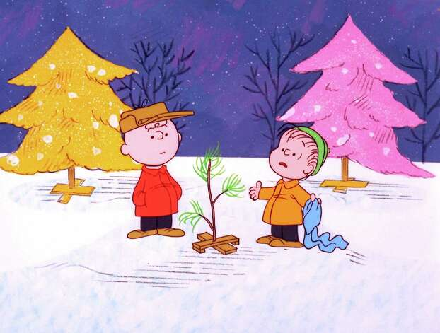 """FILE - In this file image originally provided by United Feature Syndicate Inc. VIA ABC TV, Charlie Brown and Linus appear in a scene from """"A Charlie Brown Christmas,"""" a television special based on the """"Peanuts"""" comic strip by Charles M. Schulz.   Charles Schulz' comic-strip and cartoon characters will star in their own animated film scheduled to hit theaters Nov. 25, 2015. (AP Photo/ABC,  1965 United Feature Syndicate Inc., File)  **NO SALES**    **MANDATORY CREDIT:  United Feature Syndicate Inc. ** Photo: CHARLES M. SCHULTZ / 1965 United Feature Syndicate In"""