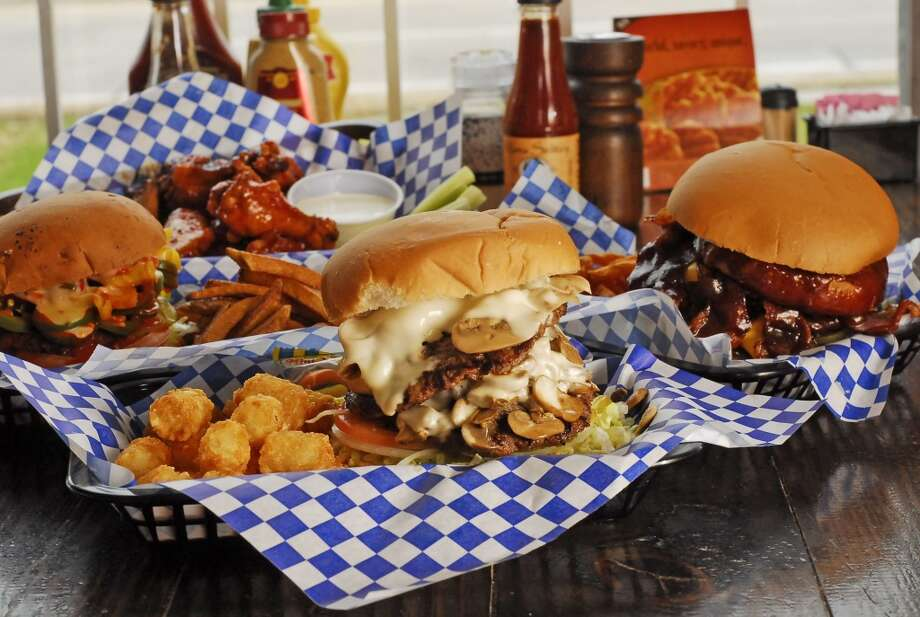 Where: Little Bitty Burger Barn 5503 Pinemont; 713-683-6700  What it is: The Double Dog Dare You  The challenge: You have 30 minutes to finish eight 1/4-pound patties, eight slices of cheese, bacon, jalapeños and barbecue sauce and one pound of seasoned fries.  The cost: $29.99  The reward: Your picture on the restaurant's wall and a t-shirt.   What it is: Charlie's 5 Alarm Fire Burger  The challenge: There's no time limit. You simply have to finish a burger topped with jalapeños, habaneros and Nitro Sauce, which registers 10,000,000 on the Scoville scale. (A jalapeño typically maxes out at 8,500 units.)  The cost: $8.99  The reward:  Bragging rights. The prize used to be a little bitty fireman's helmet. Photo: Tony Bullard, For The Houston Chronicle