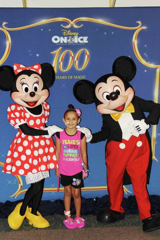 Josaliz Gonzalez, 6, was among the patients at Children's Memorial Hermann Hospital who visited with Mickey and Minnie. Photo: Courtesy Of Children's Memorial Hermann Hospital