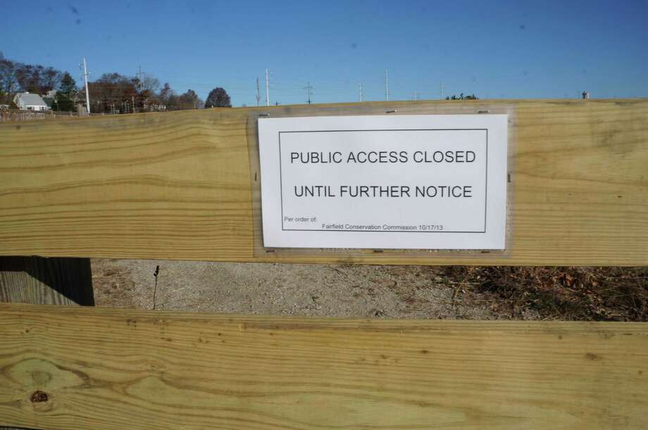 The open space area adjacent to the Fairfield Metro train station has been closed to the public by the Conservation Commission. Photo: Genevieve Reilly / Fairfield Citizen