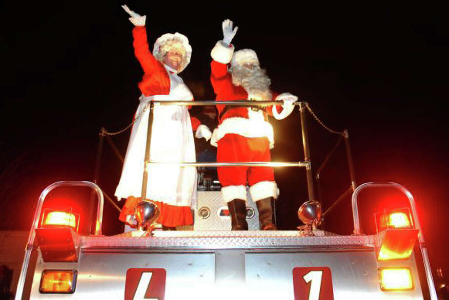 Santa and Mrs. Claus arrive at last year's Christmas tree lighting, this year to be held on Dec. 6. Nominations are being taken for someone special to light the tree. Photo: Staff Photos, Staff Photo / Fairfield Citizen