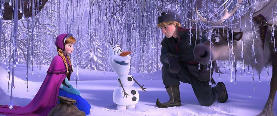 "Anna (left, voiced by Kristen Bell) is helped by snowman Olaf, mountain man Kristoff and reindeer Sven in a quest to save the frozen kingdom. The film is based on Hans Christian Andersen's ""The Snow Queen."" Photo: Walt Disney Films"
