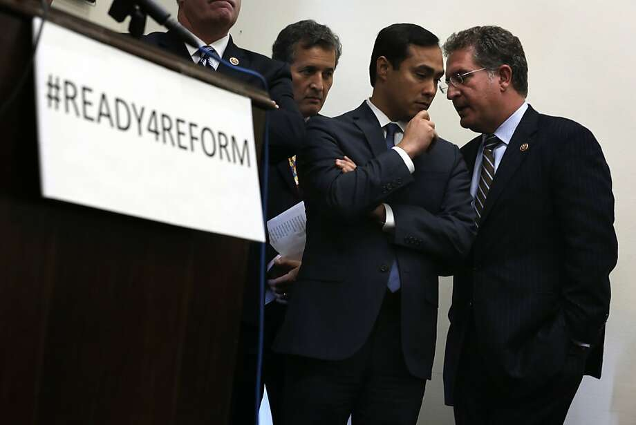 Democratic Reps. Joaquin Castro of Texas (second from right) and Joe Garcia of Florida discuss options during a news conference on immigration reform legislation on Capitol Hill. Photo: Alex Wong, Getty Images