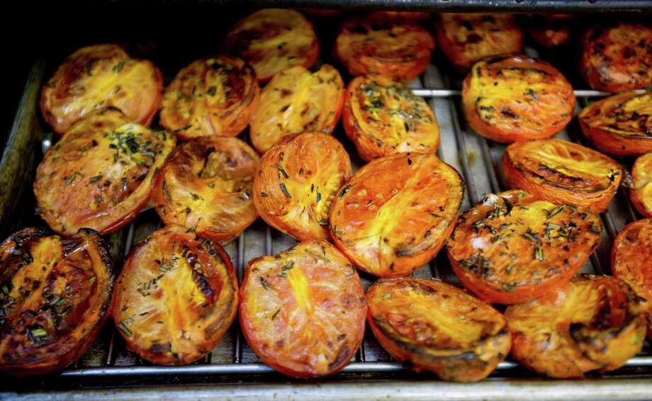 Tomatoes roast in preparation for an upcoming gala at Marcia Selden catering in Stamford, Conn., on Wednesday, November 13, 2013. Photo: Lindsay Perry / Stamford Advocate