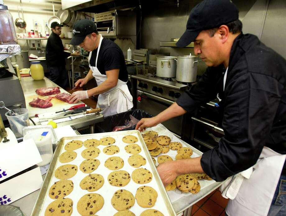 Eddie Vasquez, left, and Rosendo Morales, right, work to prepare for an upcoming gala at Marcia Selden catering in Stamford, Conn., on Wednesday, November 13, 2013. Photo: Lindsay Perry / Stamford Advocate