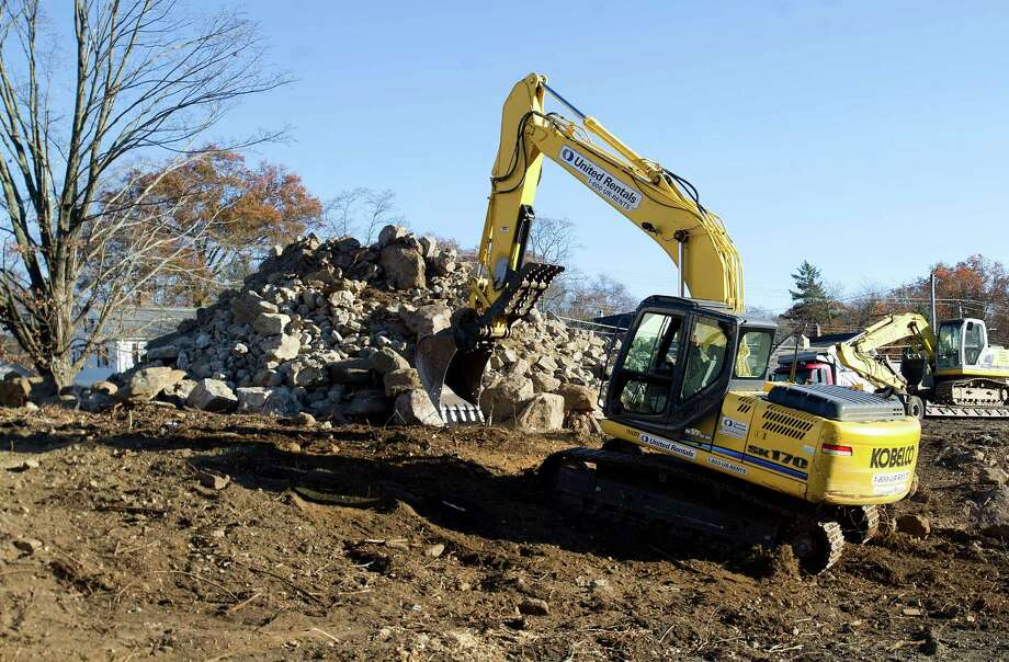 Work continues at 808 High Ridge Road in Stamford, Conn., on Wednesday, November 13, 2013, where a home built by a Revolutionary War veteran was demolished. Photo: Lindsay Perry / Stamford Advocate
