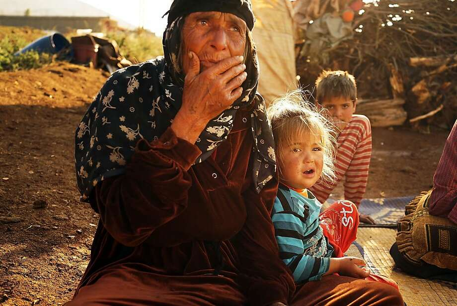 More mouths to feed: After fleeing the besieged city of Aleppo, a Syrian family waits in a makeshift camp in Lebanon's Bekaa Valley close to the border with Syria. Lebanon now has more Syrian refugees than any other country. Photo: Spencer Platt, Getty Images