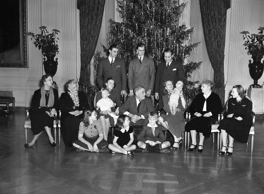 "It was a family Christmas at White House for the Roosevelt's on Dec. 25, 1939. This picture includes the performing Johnny Boettiger, nine-month-old grand son of  President Franklin D. Roosevelt, is the cynosure of all eye seated, left to right: Mrs. Eleanor Roosevelt; Mrs. Sara Roosevelt,  president's mother; Mrs. Franklin Roosevelt, Jr., with Franklin III on lap; the president; Mrs. John Boettiger president's daughter Anna and her son, Johnny; Mrs. J.R. Roosevelt (President's sister-in-law); Mrs. Anne Roosevelt; wife of son John;  standing, Franklin, Jr. and John; John Boettiger on floor, Eleanor ""Sistie"" Dall; Diana Hopkins,  Commerce secretary's daughter; and Curtis ""Bussie"" Dall, Jr. Photo: Associated Press / 1939 AP"