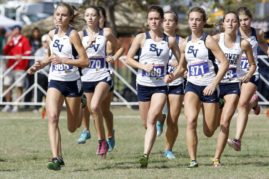 The Smithson Valley girls cross country team takes off at the start of the 5A girls 5000 meter race during the state meet in Round Rock on Saturday. Devin Clark, left, finished third overall and the team placed ninth. Photo: Marvin Pfeiffer/ Express-News
