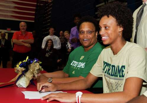 Manvel's Brianna Turner signs with the University of Notre Dame to play basketball while her mother Kellye looks on during a ceremony at Manvel High School on Wednesday, Nov. 13, 2013, in Manvel. Photo: J. Patric Schneider, For The Chronicle / © 2013 Houston Chronicle