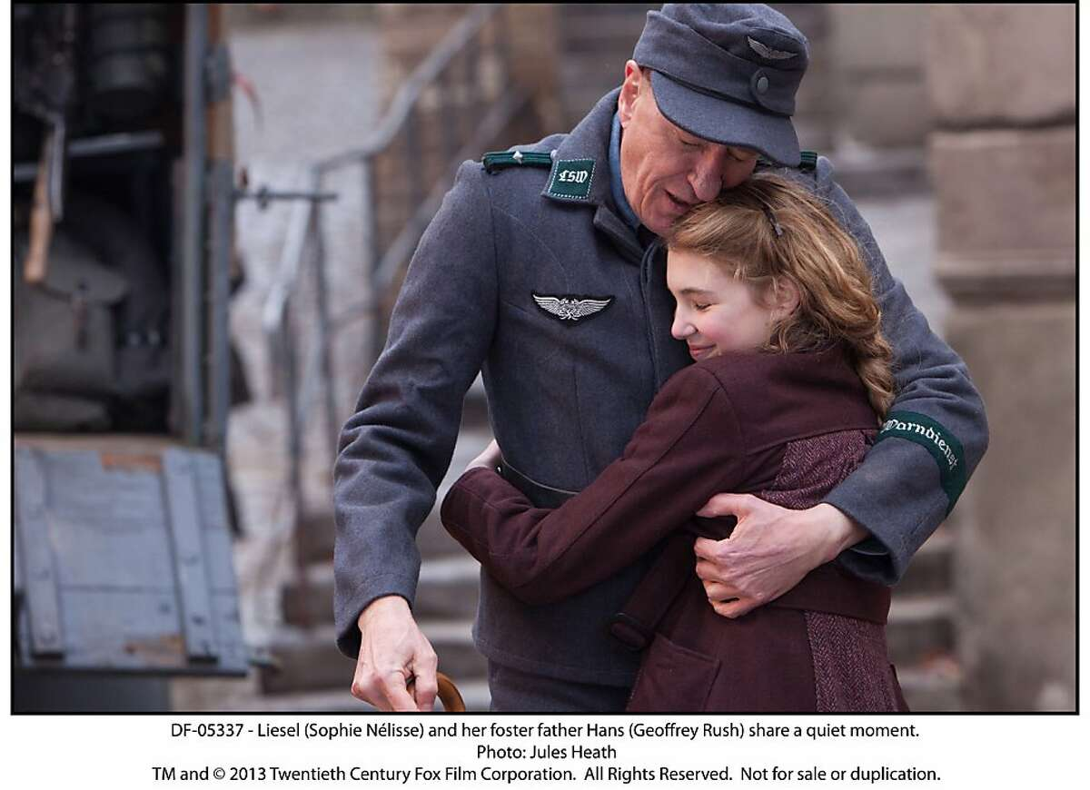 Liesel (Sophie NŽlisse) and her foster father Hans (Geoffrey Rush) share a quiet moment.