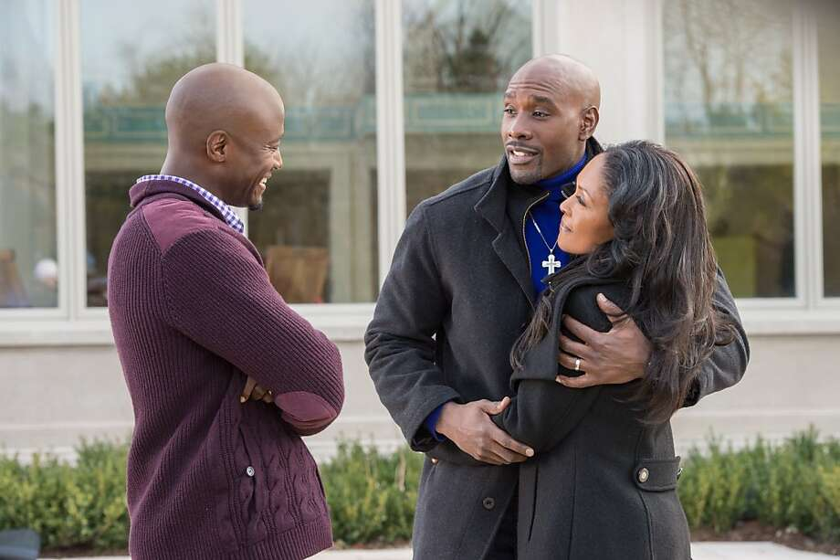 "Harper (Taye Diggs, left) hopes to get help from football star Lance (Morris Chestnut) and wife Mia (Monica Calhoun) in ""The Best Man Holiday."" Photo: Michael Gibson, Universal Pictures"