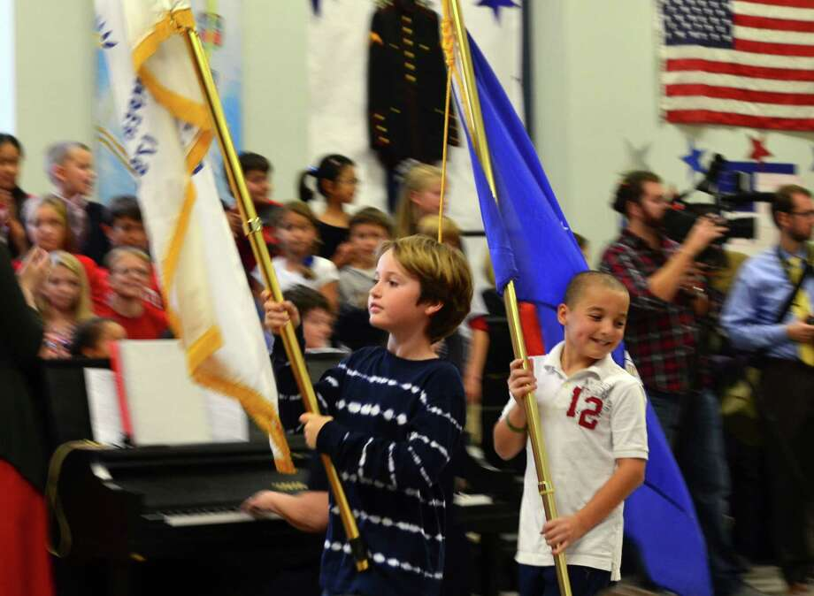 Fin Kehrli and Sean Flaker were two of five flag bearers at the Friday, Nov. 8 Veterans Day Celebration at Hindley Elementary School. Photo: Megan Spicer / Darien News