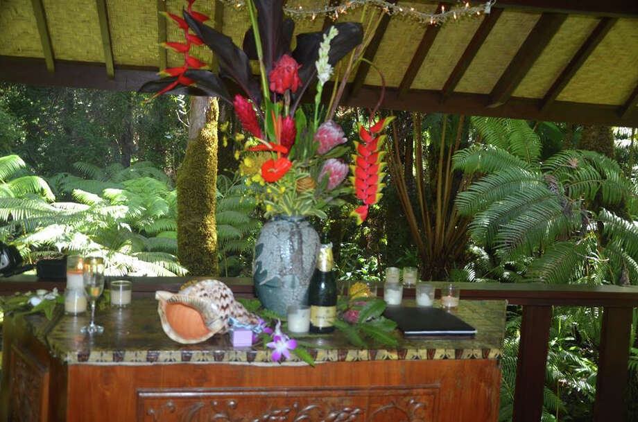 All the accoutrements necessary for an island wedding -- including a pū (conch shell) to blow at the start of the ceremony -- can be found in the Mahinuis' rainforest pavilion. Photo: Mahinui Rainforest Weddings