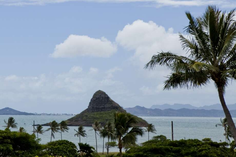 Mokoli'i Island, nicknamed Chinaman's Hat, can be seen from Kualoa Ranch's 1,000-foot elevation Palikū Gardens wedding venue. Photo: Daeja Faris, HTA