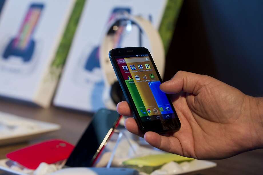 "The new low cost smartphone of Motorola, ""Motorola Moto G"", is displayed in Sao Paulo, Brazil on November 13, 2013. The smartphone, with dimensions 65.9mm W x 129.9mm H x 6.0 - 11.6mm D is equipped with a Qualcomm Snapdragon 400 with quad-core 1,2 GHz CPU, a 4.5-inch display and Android Operating System 4.3 and a suggested price of $ 179 USD.  AFP PHOTO / NELSON ALMEIDANELSON ALMEIDA/AFP/Getty Images Photo: Nelson Almeida, AFP/Getty Images"