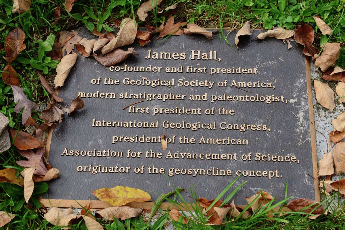 Historical marker at the grave of James Hall highlights his vast career in geology.
