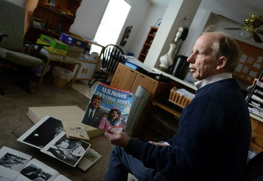 Arthur Rickerby, Jr., son of the famous LIFE Magazine photojournalist Arthur Rickerby, shows off a magazine with his father's photo on the cover inside his home in Bethel, Conn. on Wednesday, Nov. 13, 2013.  Rickerby, Sr. was a few cars behind John F. Kennedy in the Dallas motorcade when the president was assassinated.  Friday, Nov. 22 marks the 50 year anniversary of that day. Photo: Tyler Sizemore / The News-Times