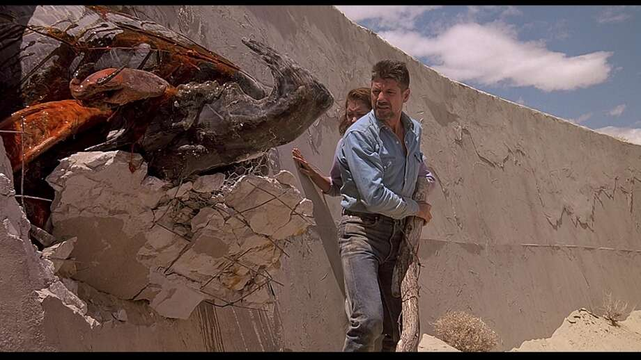 Tremors  This 1990 sci-fi/horror film starred Kevin Bacon, Fred Ward, Michael Gross and Reba McEntire. The film went on to have two sequels.