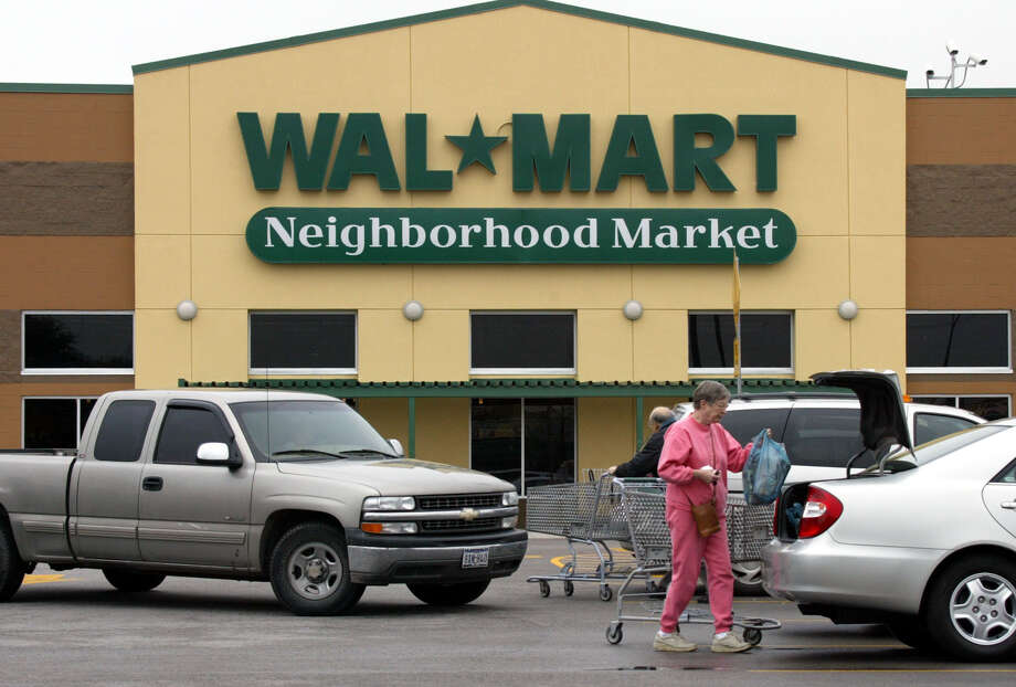 A Wal Mart Neighborhood Market is shown in Dallas. Photo: DONNA MCWILLIAM, AP / AP